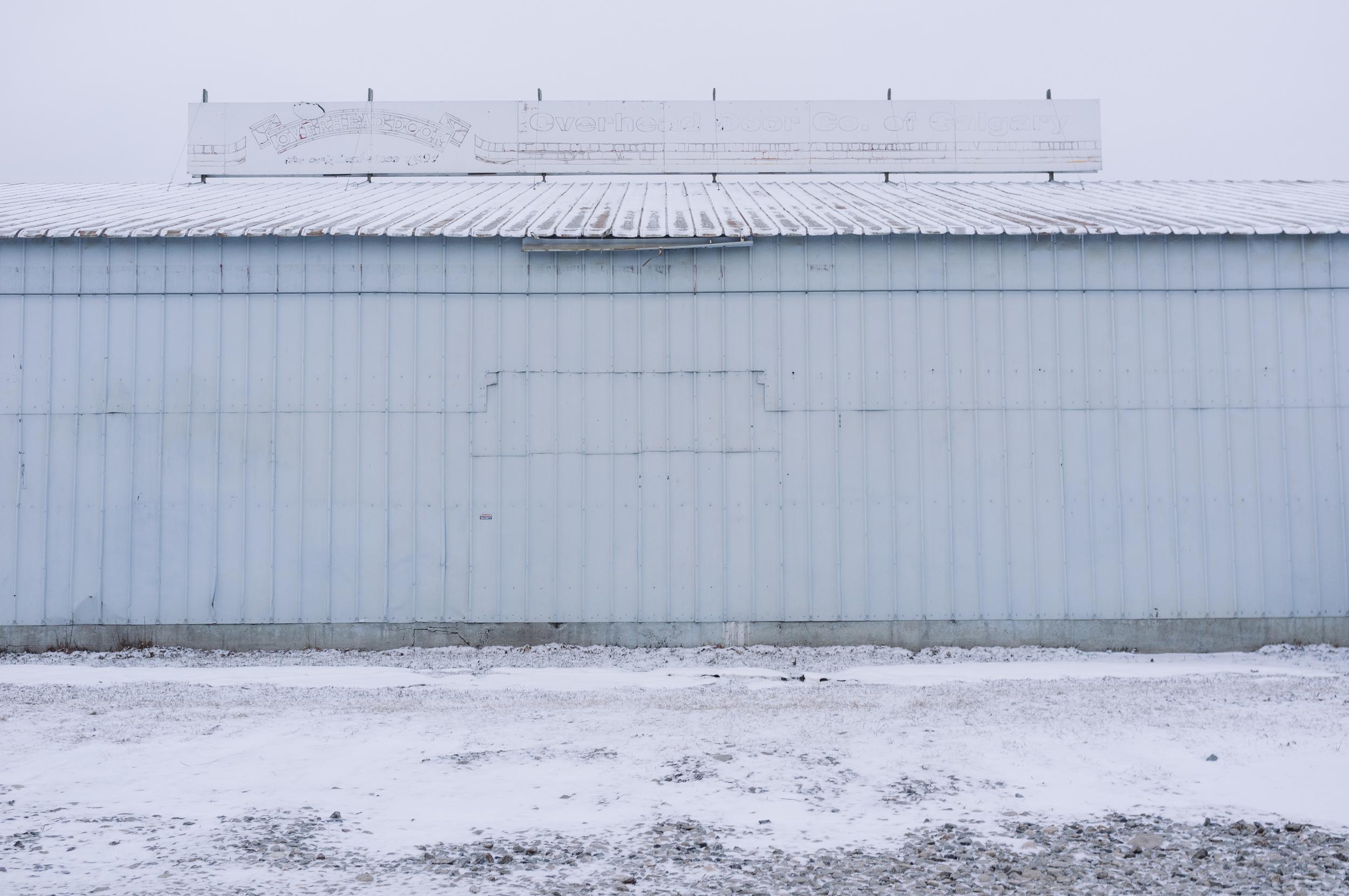Revisiting old, favourite locations. Overhead Door. Ramsay, Calgary, Alberta, 2013.