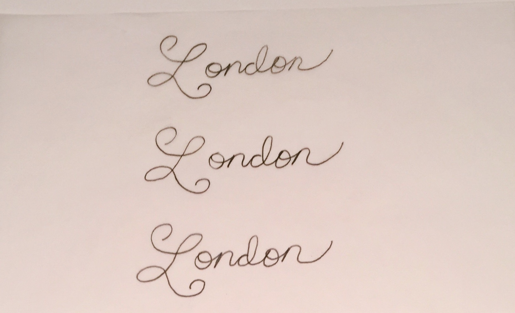 The lettering process begins with sketching out some ideas for the lettering on paper.