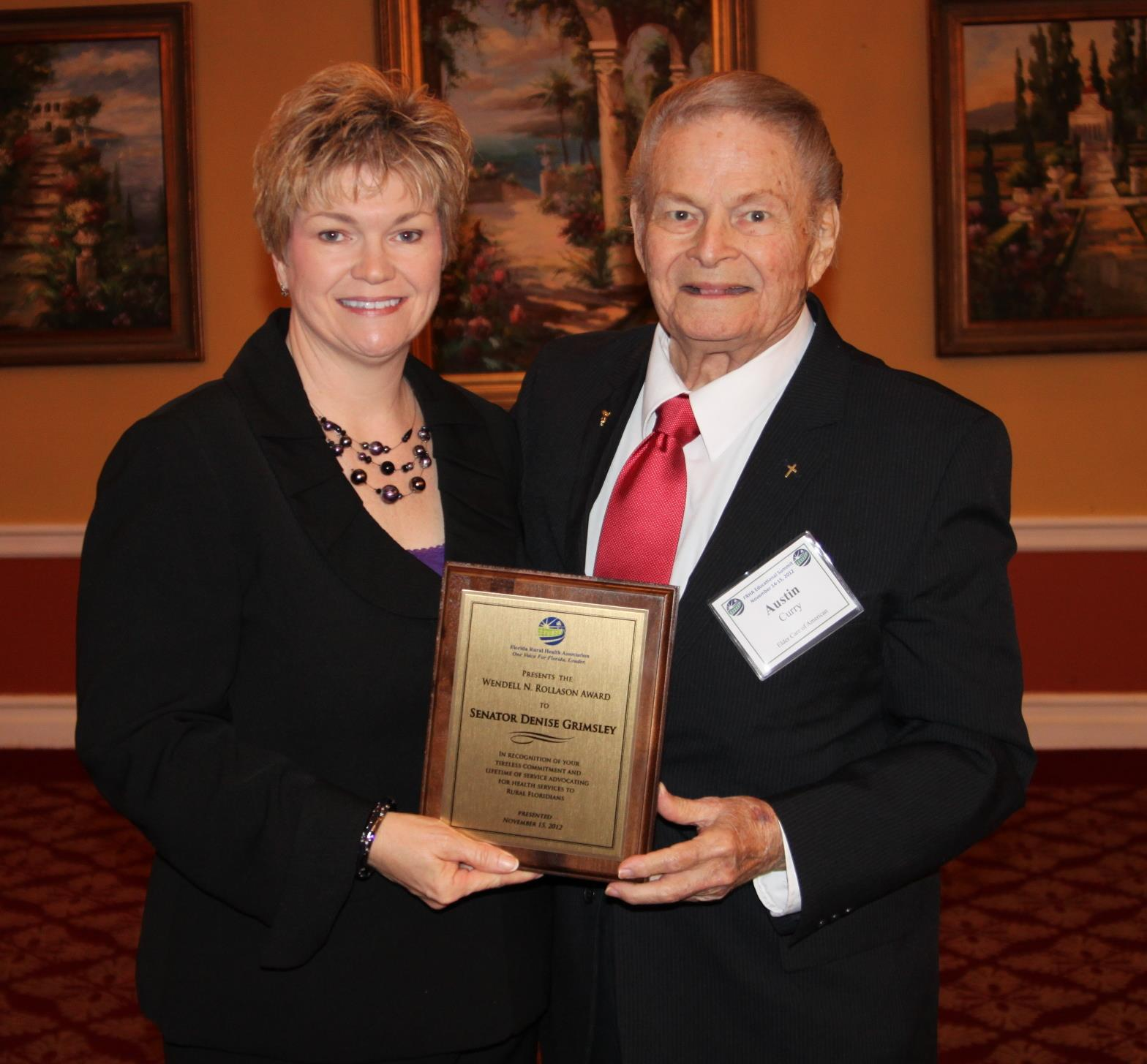 Marty Mielke, chief legislative assistant to Senator Denise Grimsley, accepted the Wendell Rollason Award on behalf of Senator Grimsley during the 2012 FRHA Educational Summit. Mielke is pictured with Austin Curry, executive director of Elder Care Advocacy of Florida, who nominated Grimsley for the award.