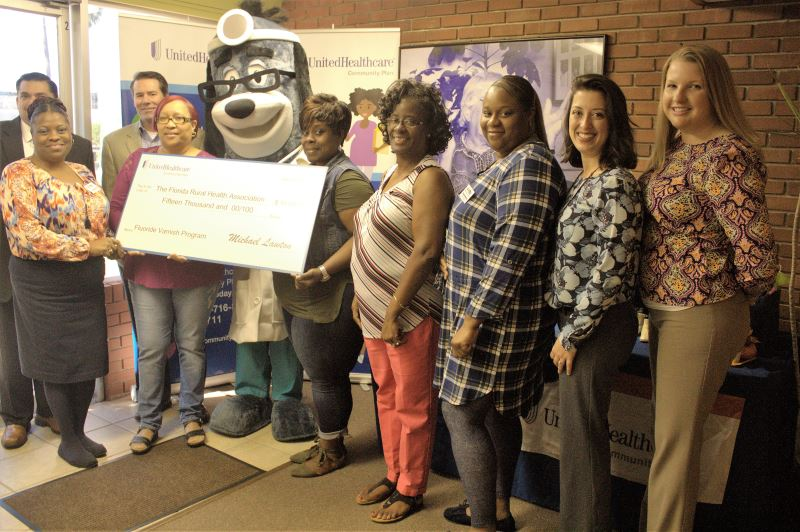 RCMA and FRHA representatives gather with United Healthcare officials for the check presentation.