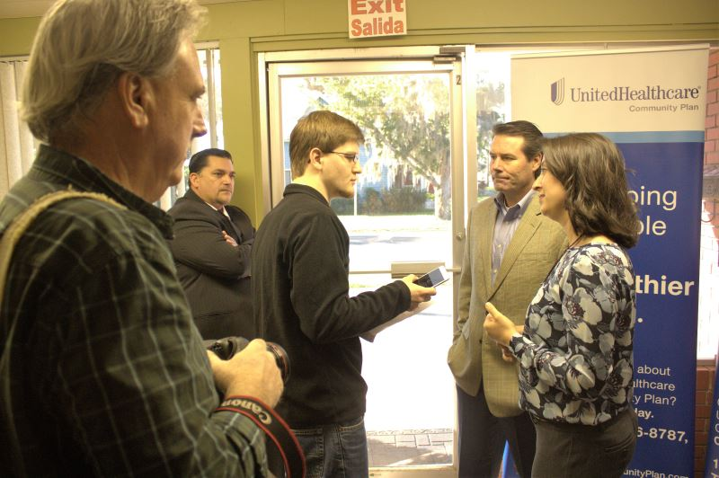 FRHA Director Sarah Catalanotto and United Healthcare Community Plan of Florida CEO Michael Lawton speak to a reporter from the Palatka Daily News.