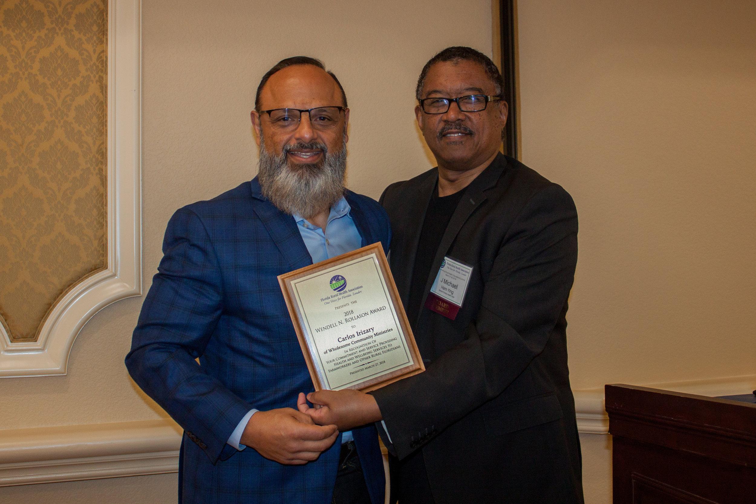FRHA President Michael Ham-Ying presents Carlos Irizarry the 2018 Wendell Rollason Award.