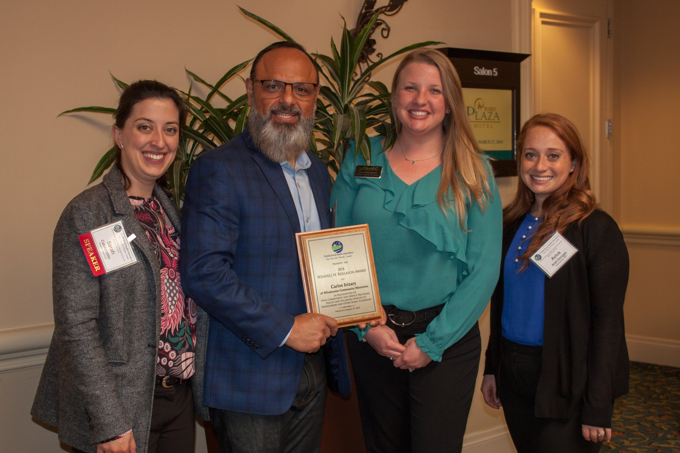 2018 Wendell Rollason Award recipient Pastor Carlos Irizarry of Wholesome Community Ministries poses with Suwannee River AHEC staff Sarah Catalanotto, Laura Hampson and Aviva Ariel-Donges.