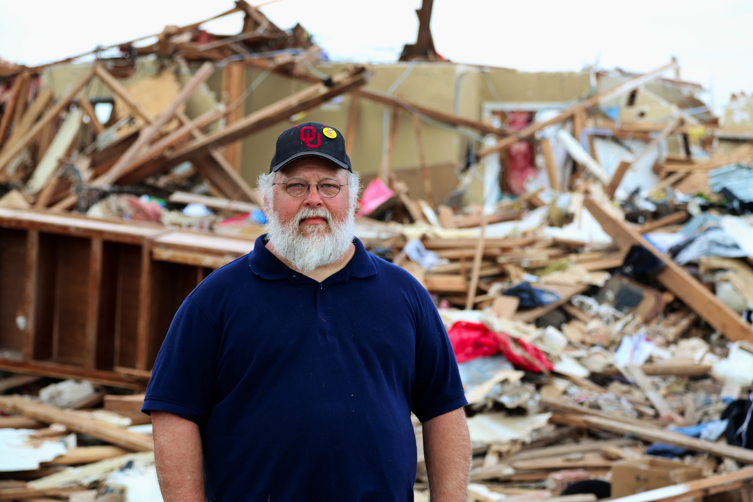 Dave Pruitt stands behind his house in the Westmoore Addition neighborhood in Oklahoma City, just a few blocks east of  Briarwood Elementary School .