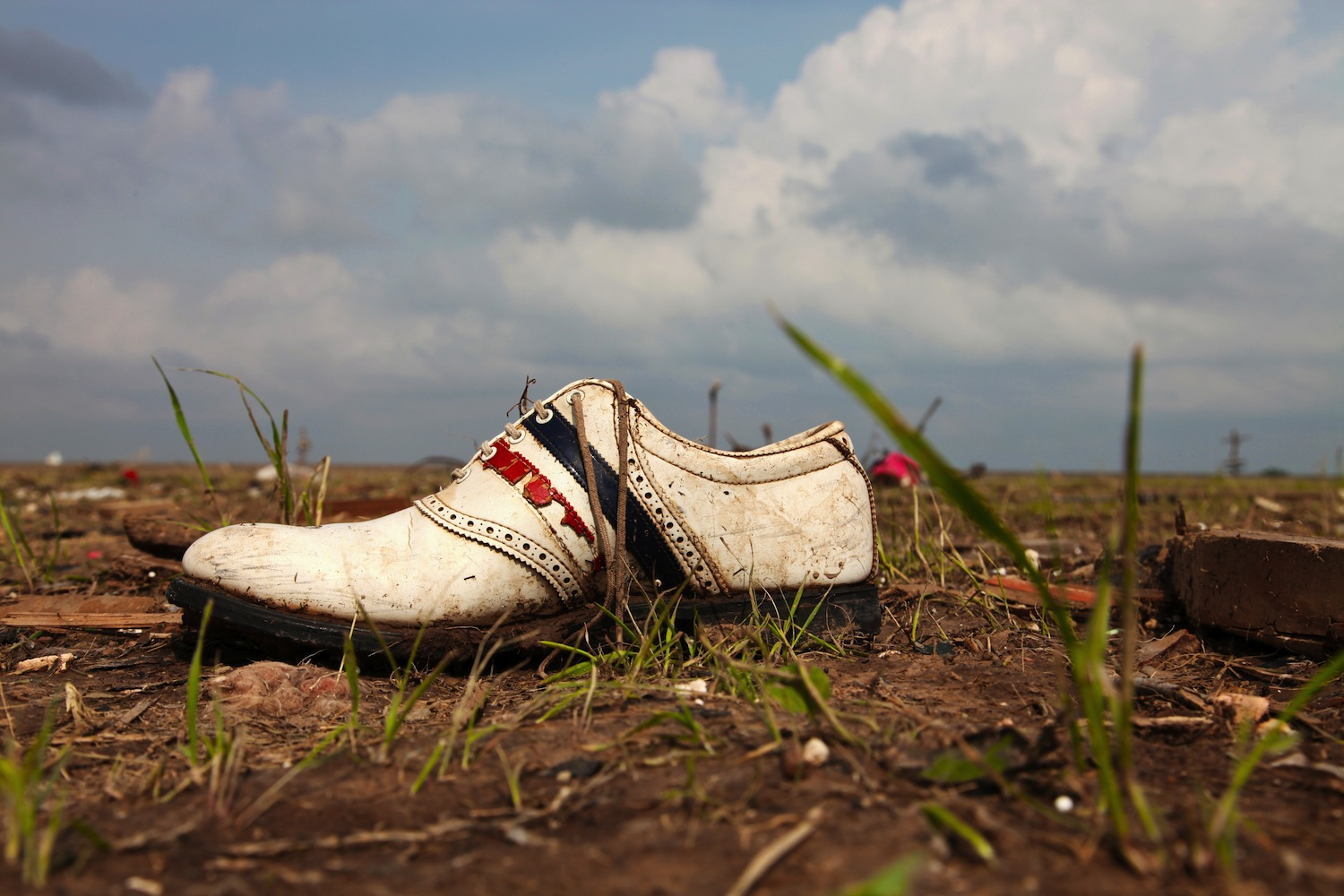 In Moore, the twister destroyed the local bowling alley -- and deposited this shoe in a field about 300 yards away.