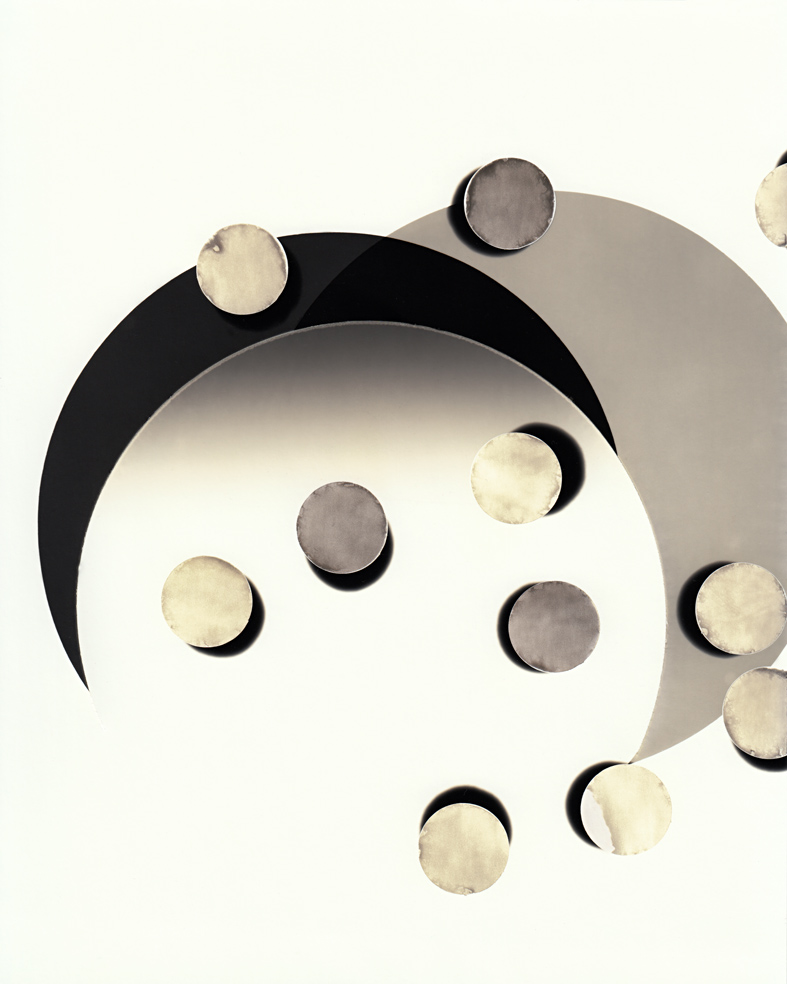 Circle work 15,  2013  cut solarised silver gelatin print (photogram) with toner  25.4 x 20.3 cm