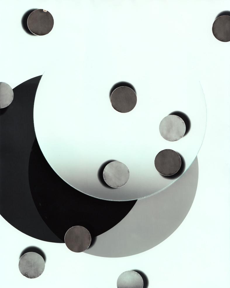 Circle work 18, 2013 cut solarised silver gelatin print (photogram) with toner 25.4 x 20.3 cm