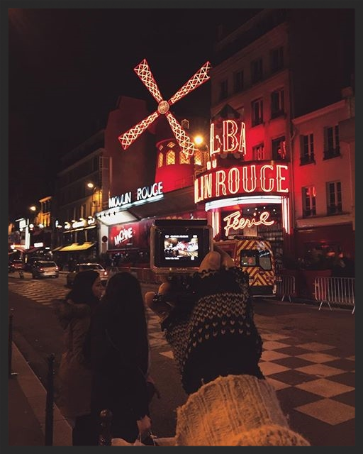This is the Moulin Rouge, the first electric powered building in the city, an historic entertainment institution that survived two world wars, a devastating fire in 1915 and several economic crisis. A symbol of Paris bohemian era made up of dances & shows.