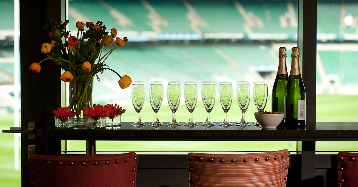 Stylish bar stools placed in front of the bespoke granite bar allow comfortable viewing of the pitch.