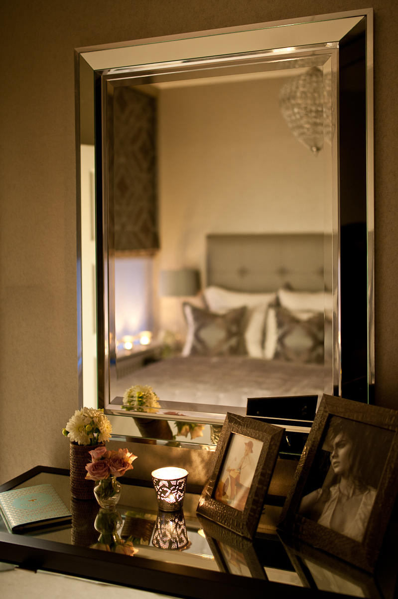 Mirrored furniture helps to keep the smallest guest bedroom feeling light and spacious.