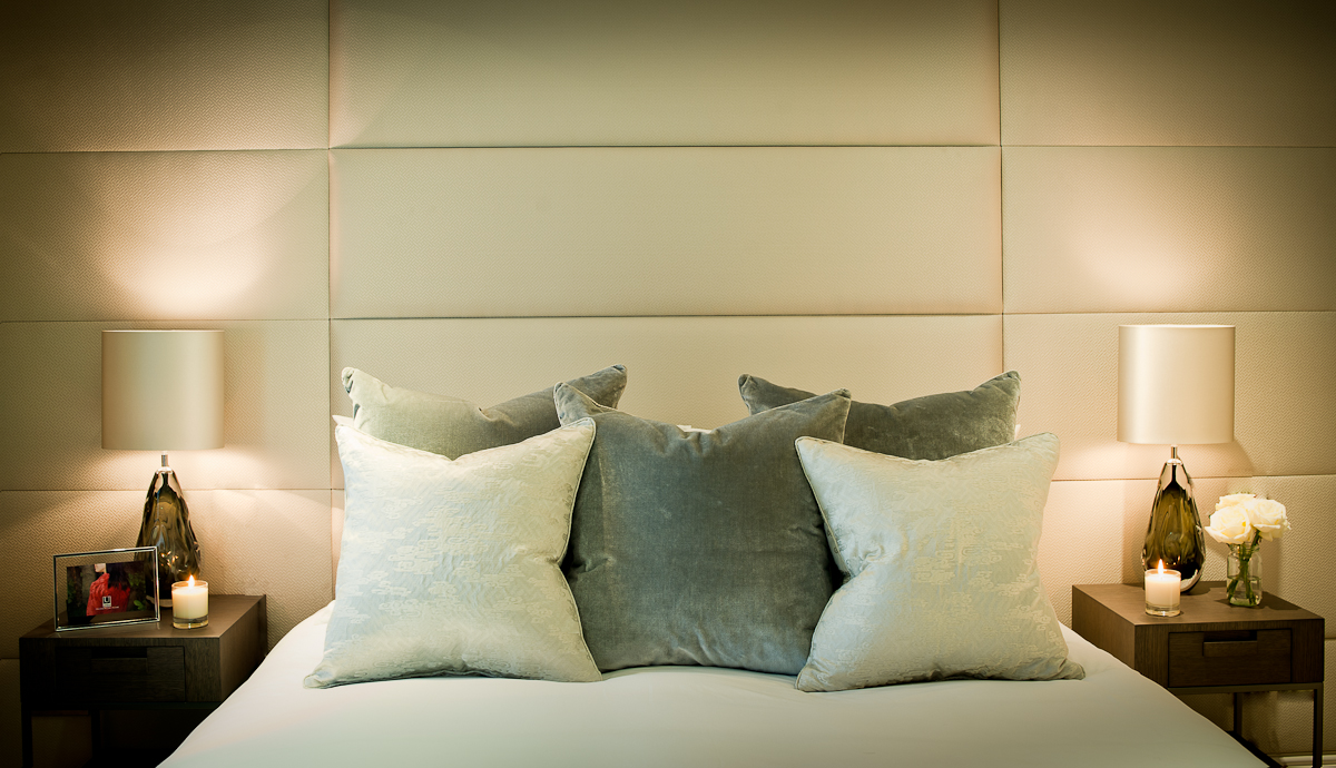 We upholstered the entire wall in the master bedroom with soft silk panels and these act as the bed's headboard as well.