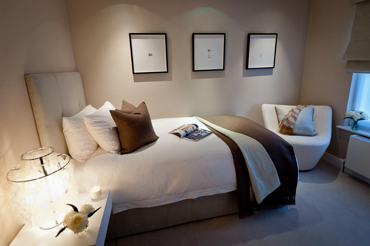 A cosy guest bedroom in calm, earthy tones.