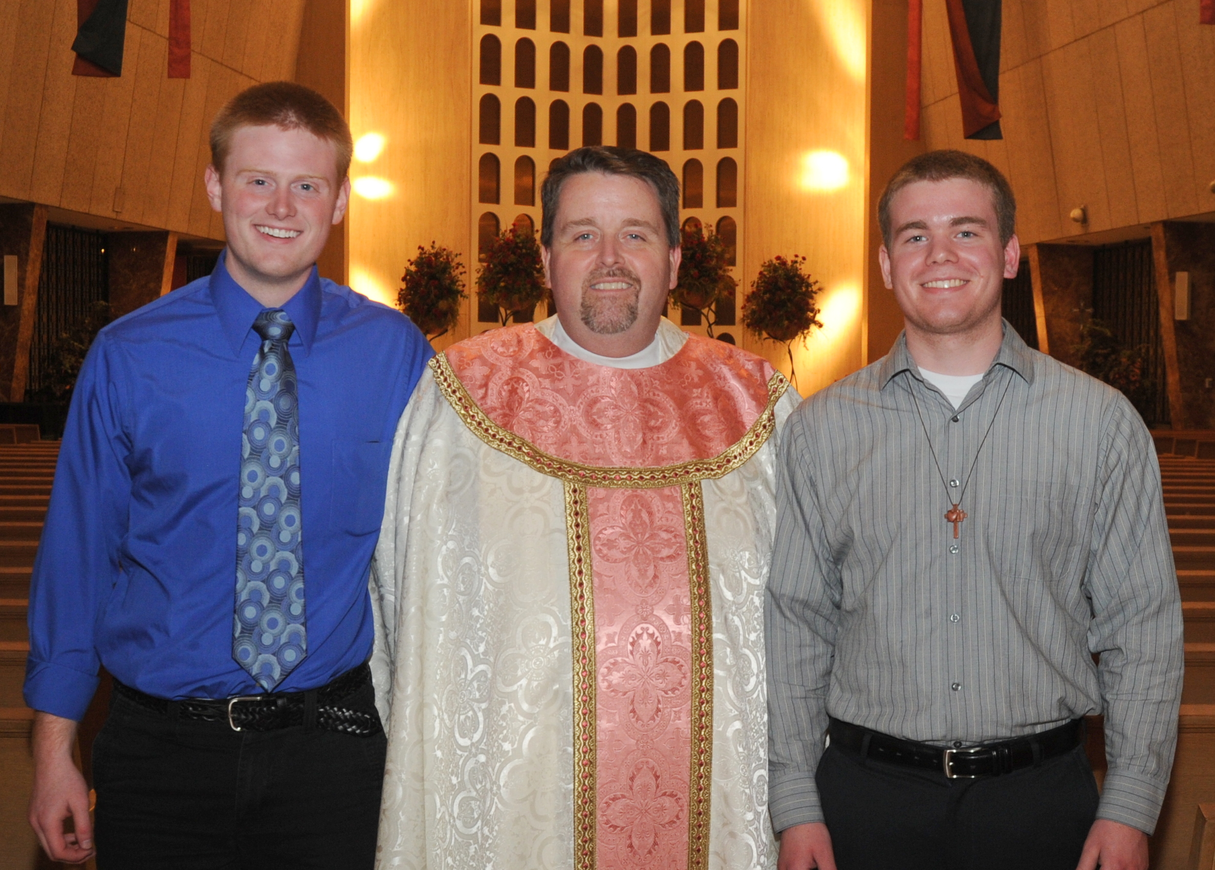 Fr. Tom McCarthy, O.S.A. with two Augustinian Pre-novices