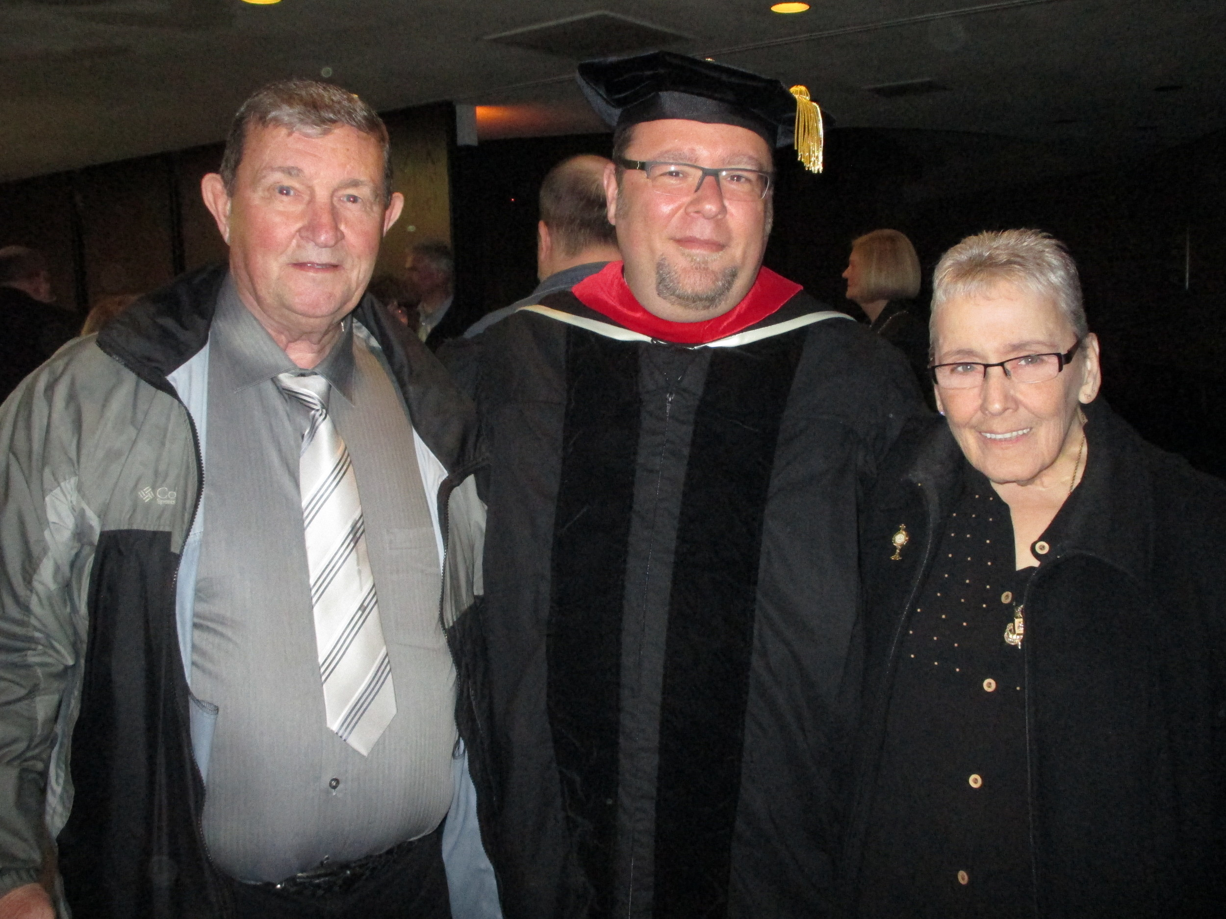 Rev. Rich Young, O.S.A., D.Min., pictured with parents Rich & Barb Young, was awarded his doctorate from Catholic Theological Union on May 15, 2014