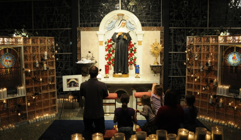 CHICAGO, IL: Guests praying at the Shrine to Saint Rita of Cascia