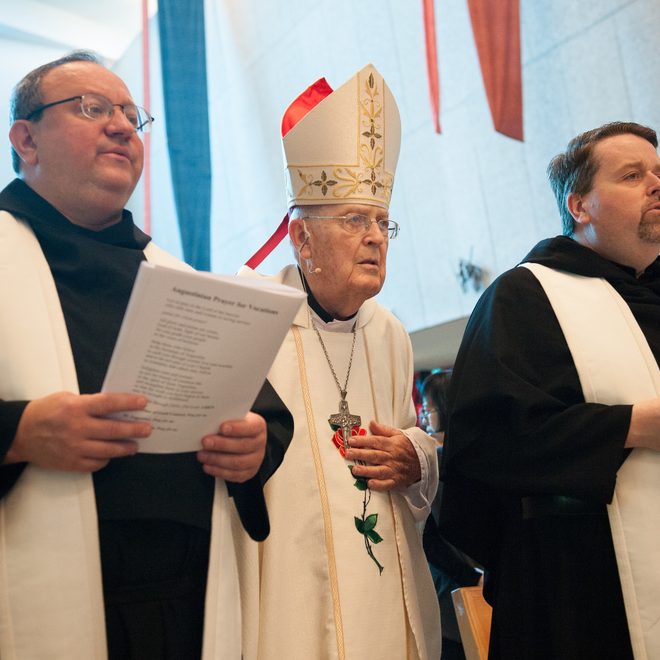 Bishop John McNabb, O.S.A. (center); with Fathers Bernie Scianna, O.S.A. (left); and Tom McCarthy, O.S.A. (right) at Saint Rita Shrine Chapel in 2014