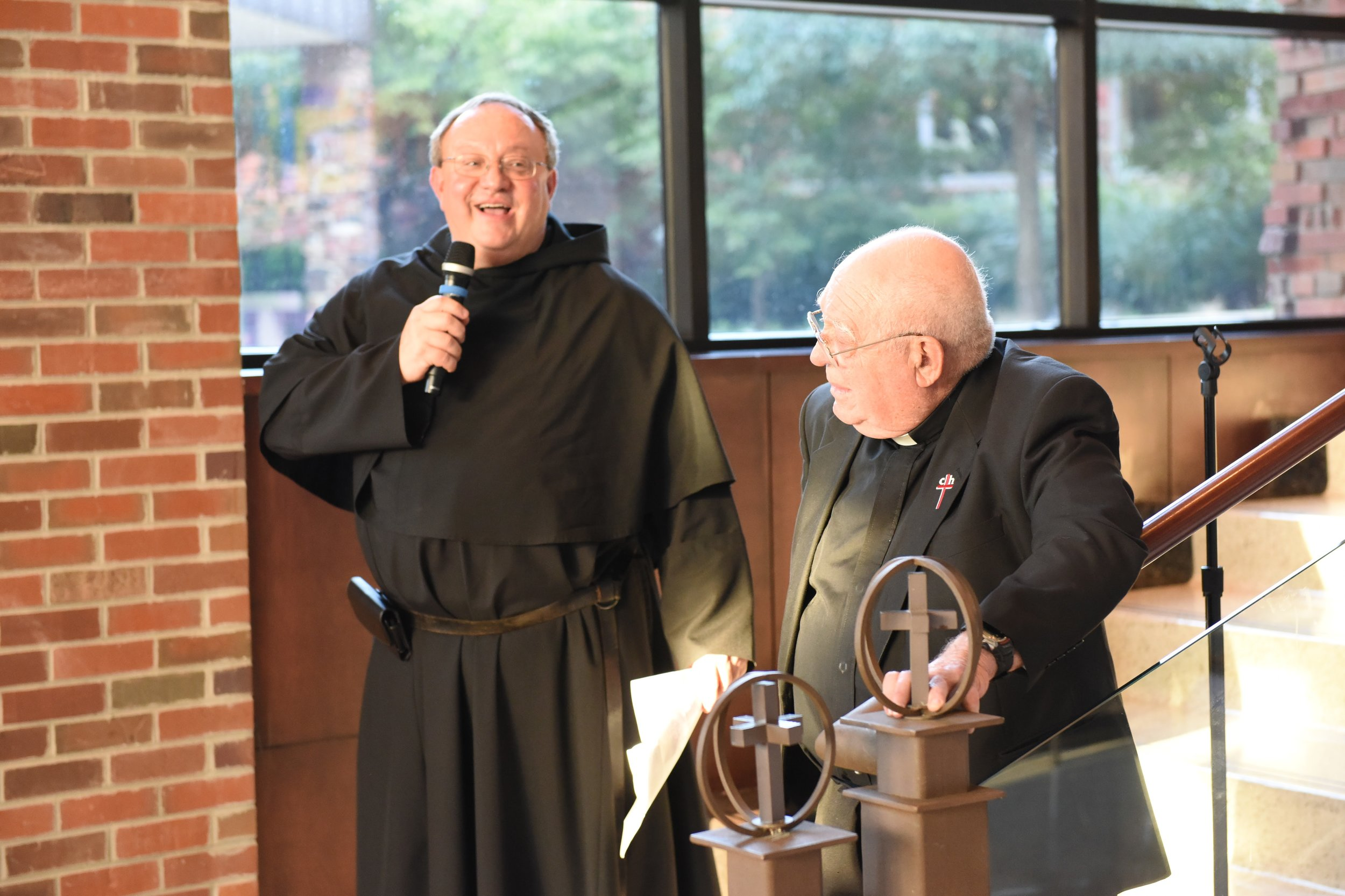 Fr. Bernie Scianna, OSA, speaking with Fr. Bill Perez, OSA, at the 2016 Tulsa Reception