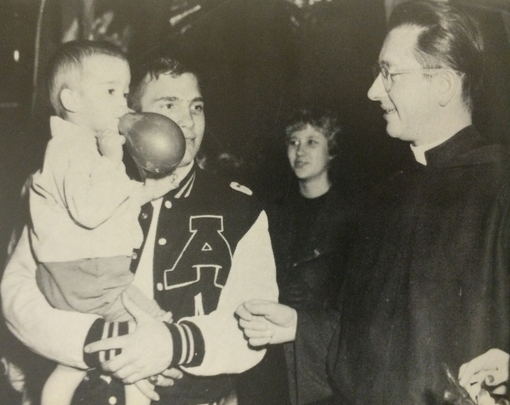Don Berschback in high school with his younger brother Chip and Fr. Malbusch