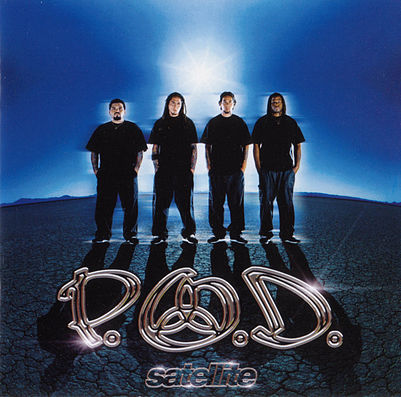 """I stumbled across  P.O.D.  in a small Christian book store in Marietta, GA while visiting my cousin the summer of 1997. An employee and friend of my cousin (would eventually become her husband) pointed me towards the """"alternative music"""" section. That's where I stumbled across  P.O.D. 's   Live at TomFest '97  album . The album art intrigued me so I popped the demo CD into the CD player and was floored. I had never heard anything like it. From that day forward I lived and breathed every word - every note of that album. I began to search out their previous and following records - it's easy to say I was obsessed... Just ask anyone I went to high school with - I adored this band.   As the years went by I lived for the Tuesday's that a new album of theirs would hit the streets. I had September 11, 2011 marked on my calendar and couldn't wait to use my free period to go pick up the album at my favorite music shop in the mall. I remember vividly walking from my 1st period class to my 2nd period class and someone in the stairwell saying that a bomb had gone off in New York City. Not really understanding the magnitude - I walked into my 2nd period English class to find the class of seniors from the previous period still there all eyes glued to the news on the TV - that's when we all saw the second plane hit. Then the news to the Pentagon. The air was instantly sucked out of the room and the assumption that everyone had about the situation was thrown out the window... This was  no accident . This was  intentional . This was an  attack .   School wasn't the same that day - our regular lessons were put on hold as we glued ourselves to the TV news. I took my free period as previously planned and went to an eerily vacant mall to pick up my CD. I popped into my CD player and didn't take it out for a solid month.   Without knowing it Traa, Wuv, Sonny, & Marcos had created a masterpiece of recovery for me. I drowned myself in this album musically and lyrically. Memorizing every word"""