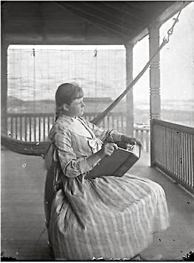 Hotel Long Beach 1890 Cottages Guest Girl Reading.JPG