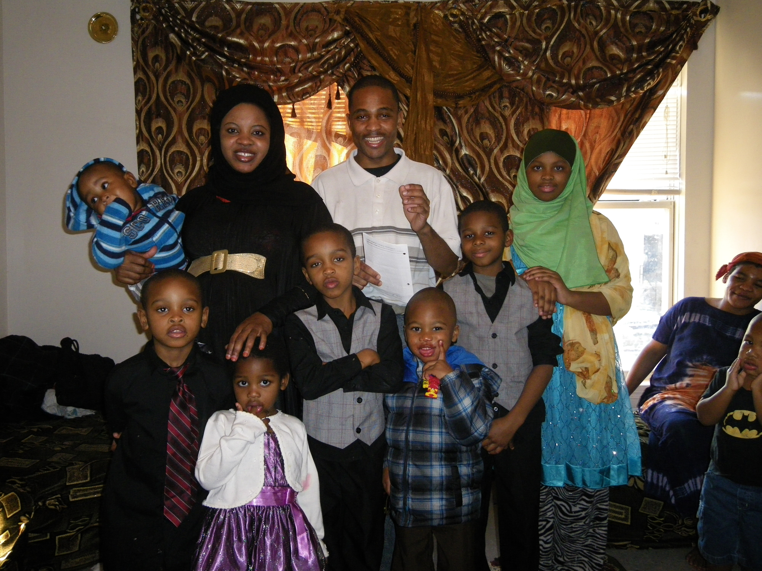 Mohamed, his wife, Mana, and their seven children