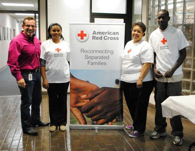 """Left to right: David Kitchen, Regional Emergency Services Director; Rachael Ngando, RFL Volunteer; Clementine Barfield, RFL Case Manager; and Kagiraneza """"Issa"""" Knuyinka, RFL Volunteer"""