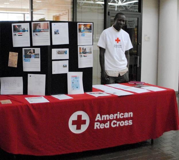 "Kagiraneza ""Issa"" Nkuyina showing display table at Nashville Area Chapter Red Cross"