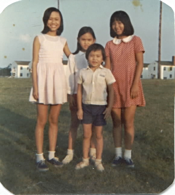 Thu-Thuy Truong with her brother, Sy, her sister, Tiffany, and a friend at Fort Chaffee, Arkansas.