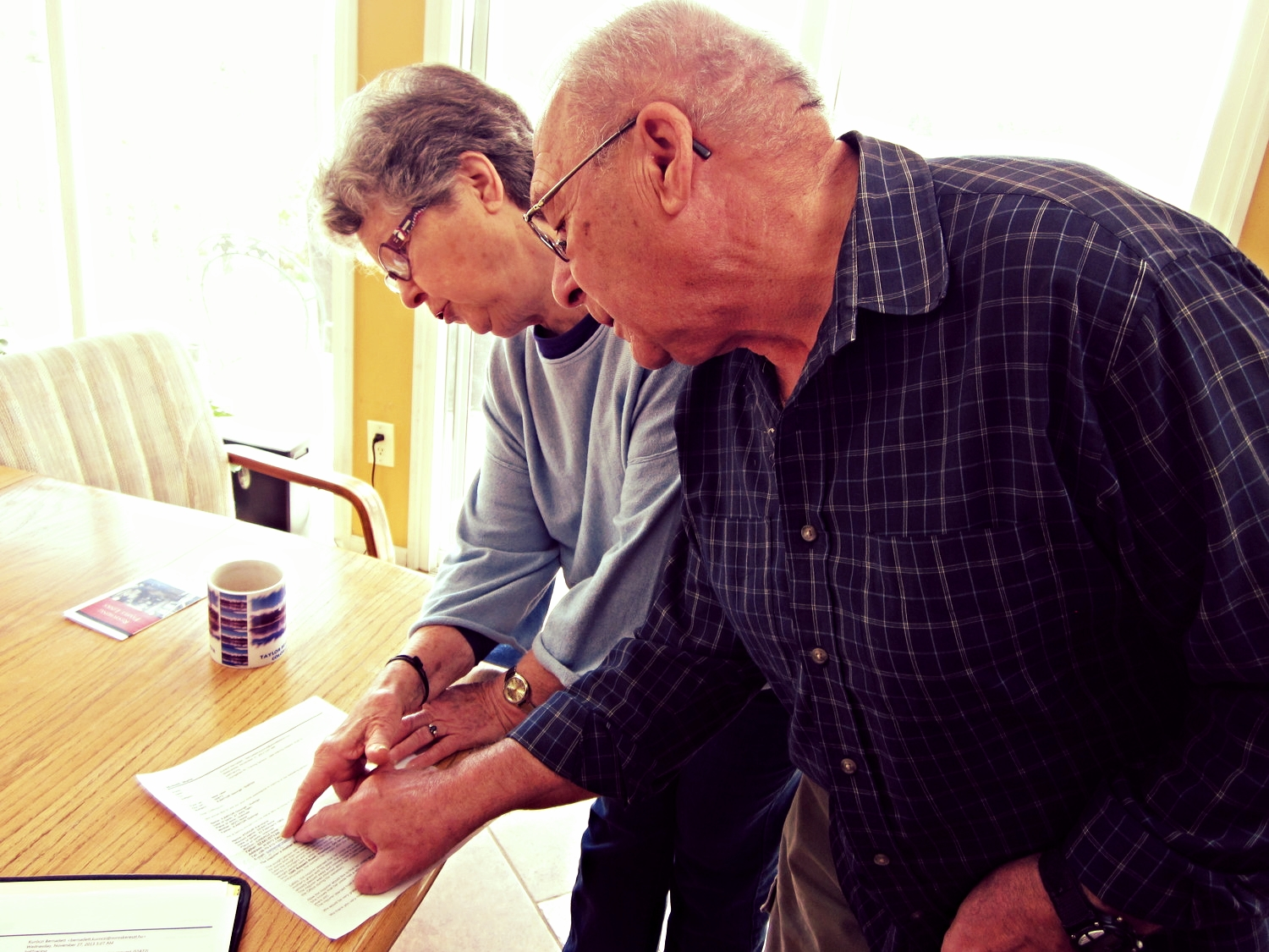 George and his wife Gretchen looking at their first message from George's niece, Karolyne.
