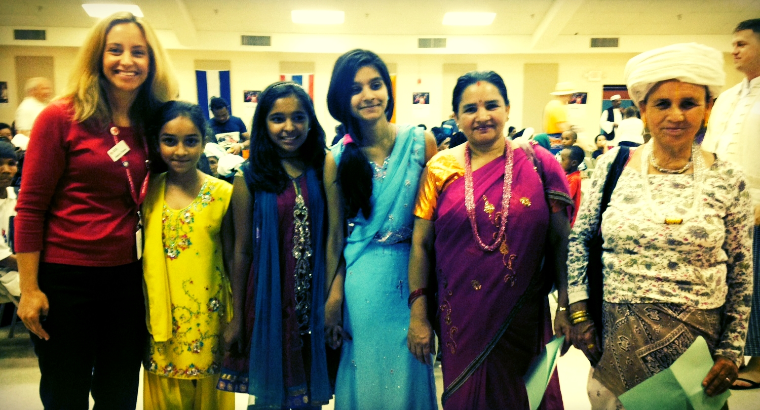 Alexis with three generations of a family from India