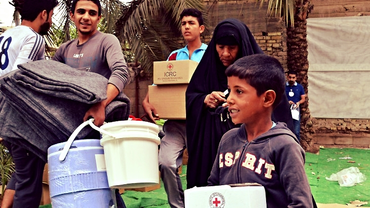 Distribution of relief to internally displaced families, Al Dura, Baghdad, Iraq, October 2014