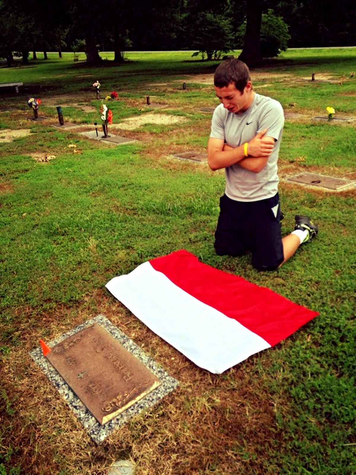 Dawid Kufel, Grandson kneelsat the headstone of his grandfather in Richmond.