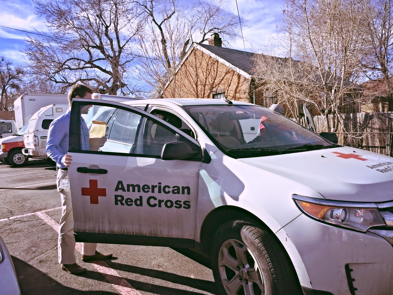 Red Cross caseworkers prepare to deliver information to elderly Russian woman looking for her family.