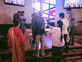 Member of the community gather in support of those affected by the earthquake in Nepal.