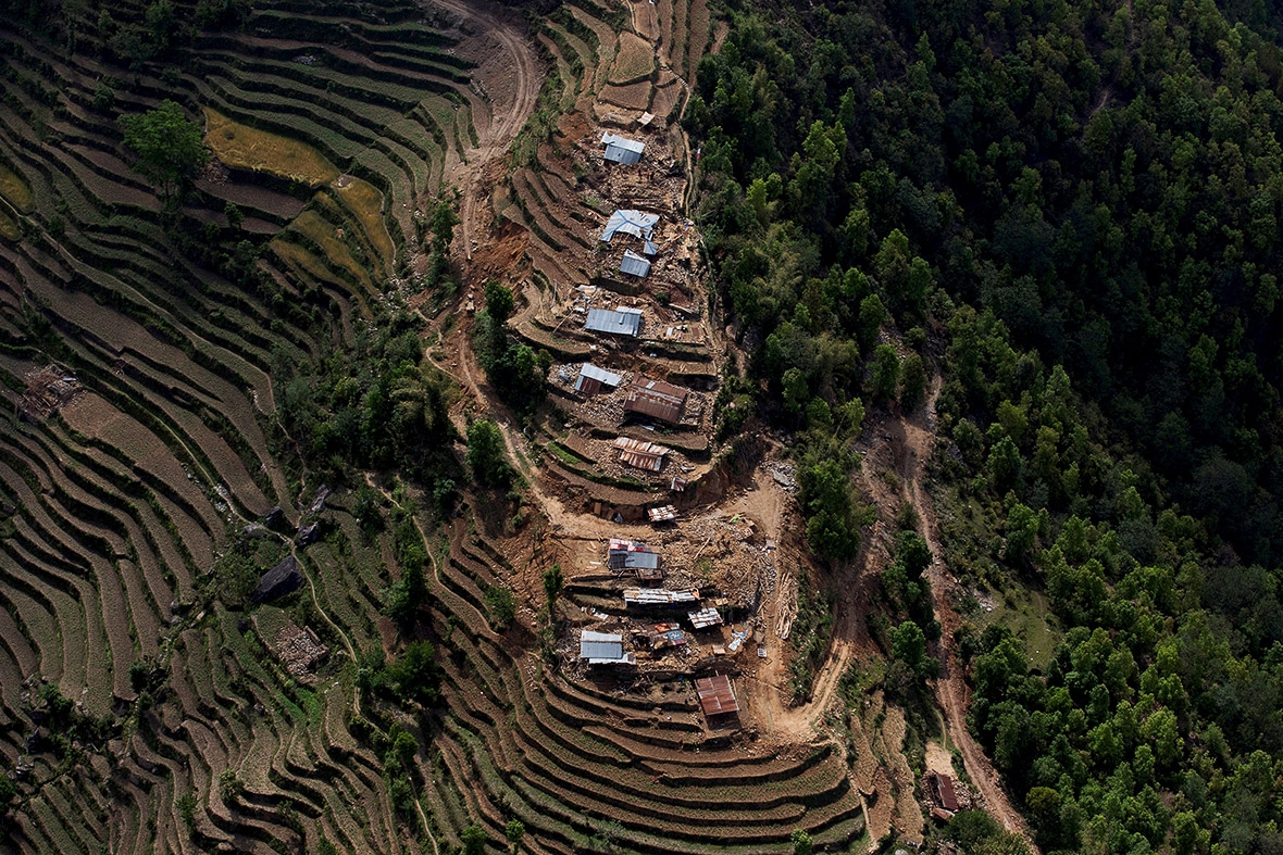 Collapsed houses and debris on steep terraced hillsides in Nuwakot are seen from a helicopter(Danish Siddiqui/Reuters)