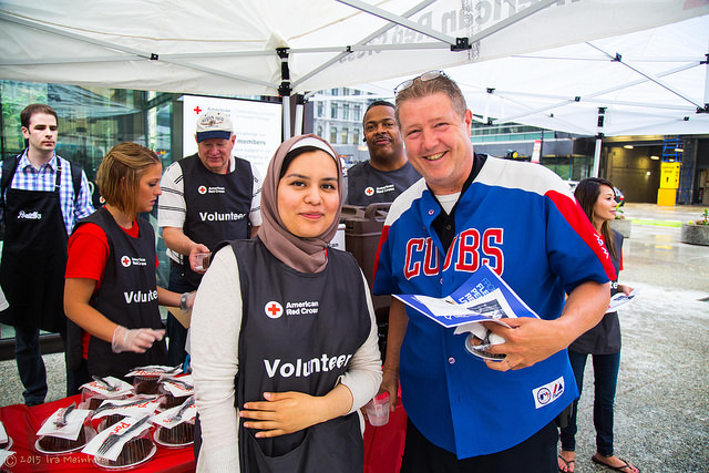 Red Cross volunteers educate the public about refugee issues and Red Cross services.