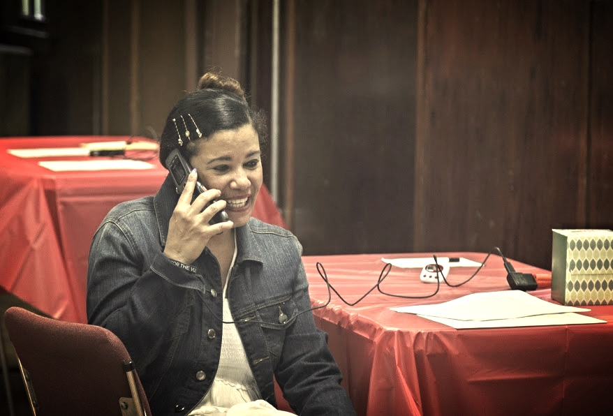 Katiusca Cespedes speaks to a cousin in Cuba while waiting for her mother to come to the phone.