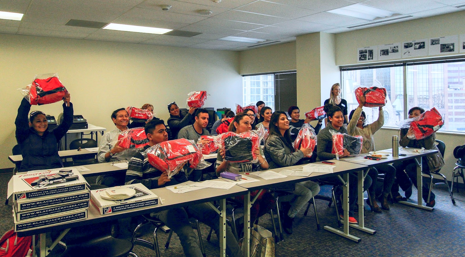 Students show off the Red Cross emergency kits they received at the end of the training. Photo credit:Styliani (Stellina) Giannitsi