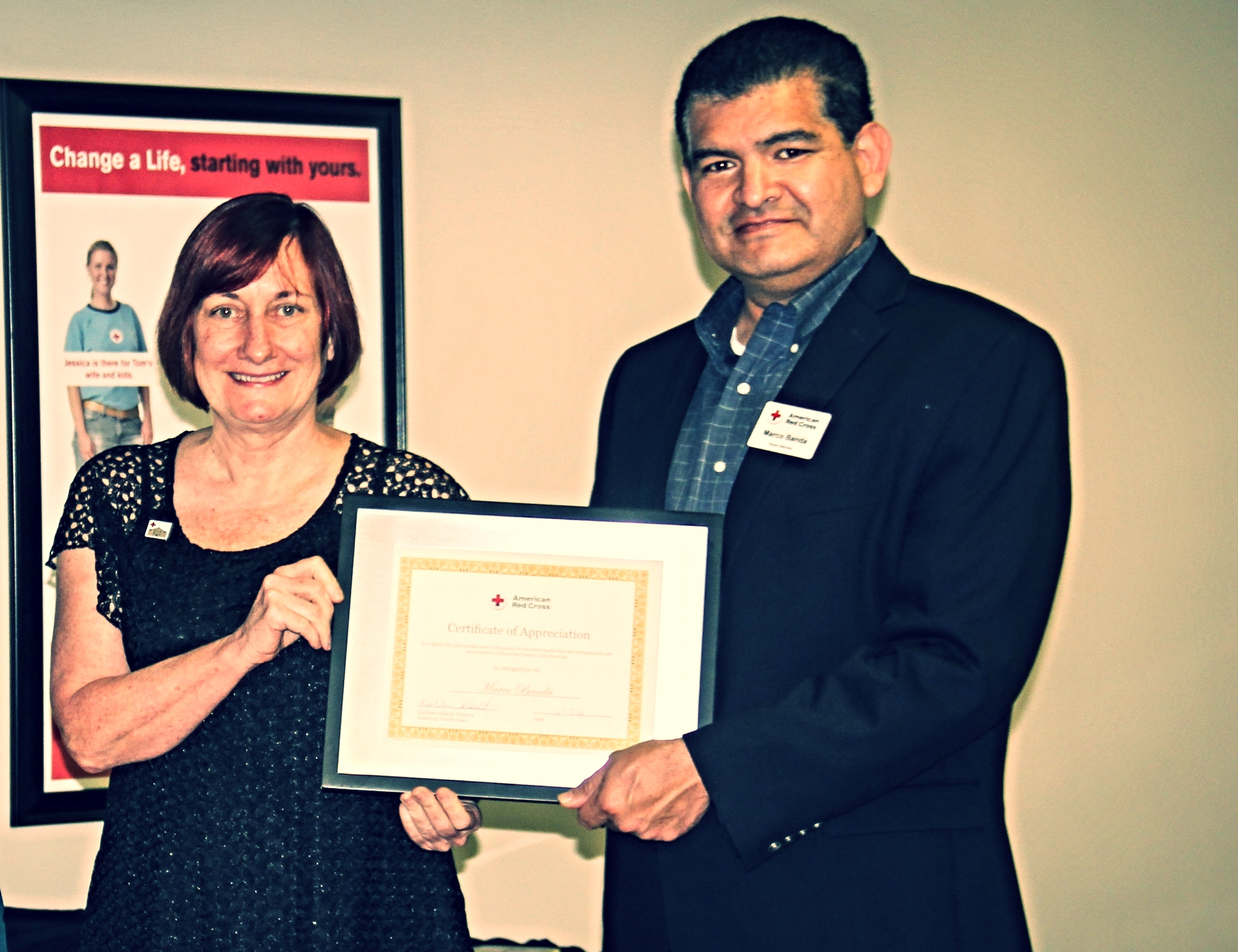 Marco Banda recognized for his dedication to the reconnecting families, and other services, of the American Red Cross.