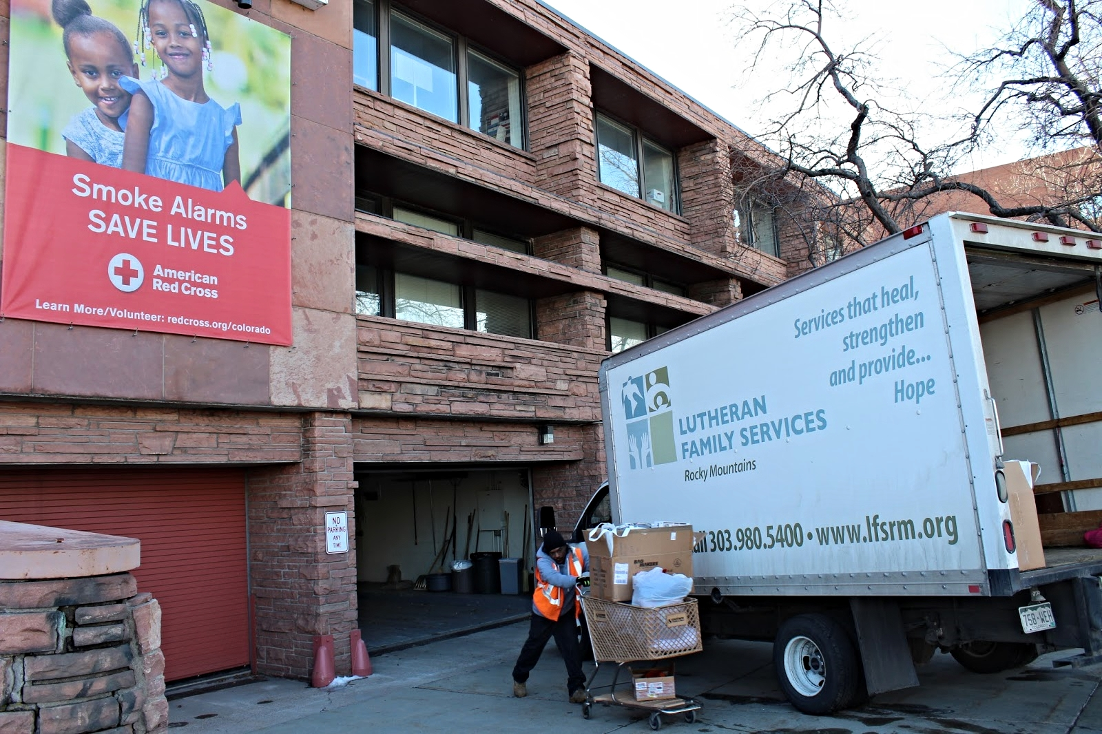A Lutheran Family Services worker loads supplies for refugee welcome kits from the Red Cross.