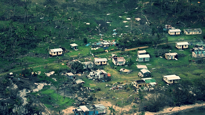 Debris is scattered around damaged buildings at Nakama settlement in Fiji, after Cyclone Winston tore through the island nation. Photo credit: AP.