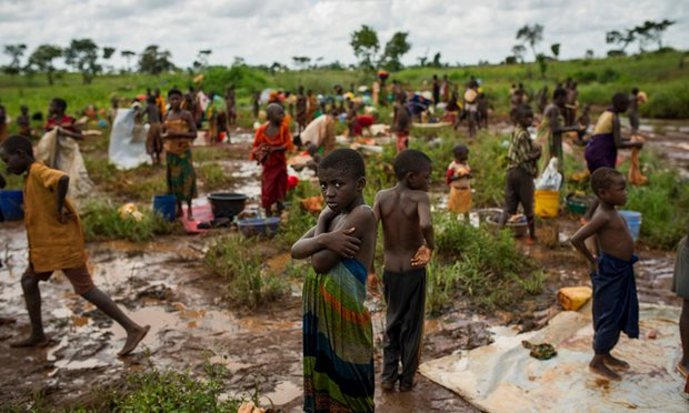 Burundi refugees wash their clothes near a river on the edge of the Nyarugusu refugee camp in Tanzania. Photograph: Phil Moore/Oxfam