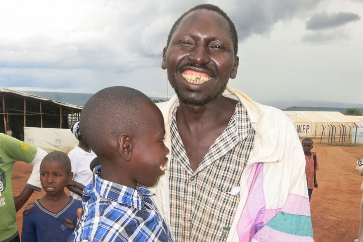 Ernest and his father show their joy at being reunited. Photo credit: BY-NC-ND / ICRC / E. Nyandwi