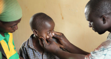 With no ophthalmologist on site, there is little Red Cross staff can do for 6-year-old Levisi's chronic eye infection, which they say is slowly making him blind. Photo Credit: Niki Clark, American Red Cross.