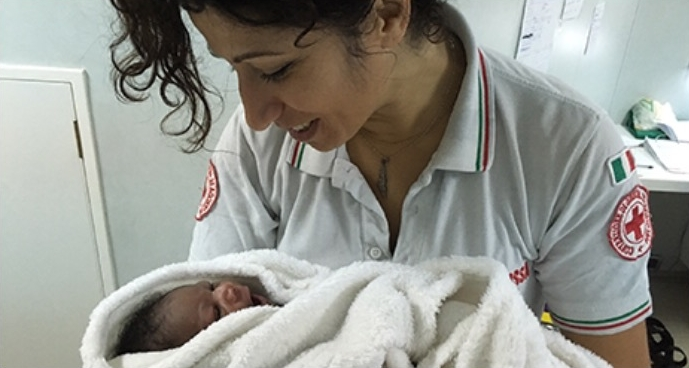 IFRC Medical team is taking care of the new born. Iris van Deinse/IFRC