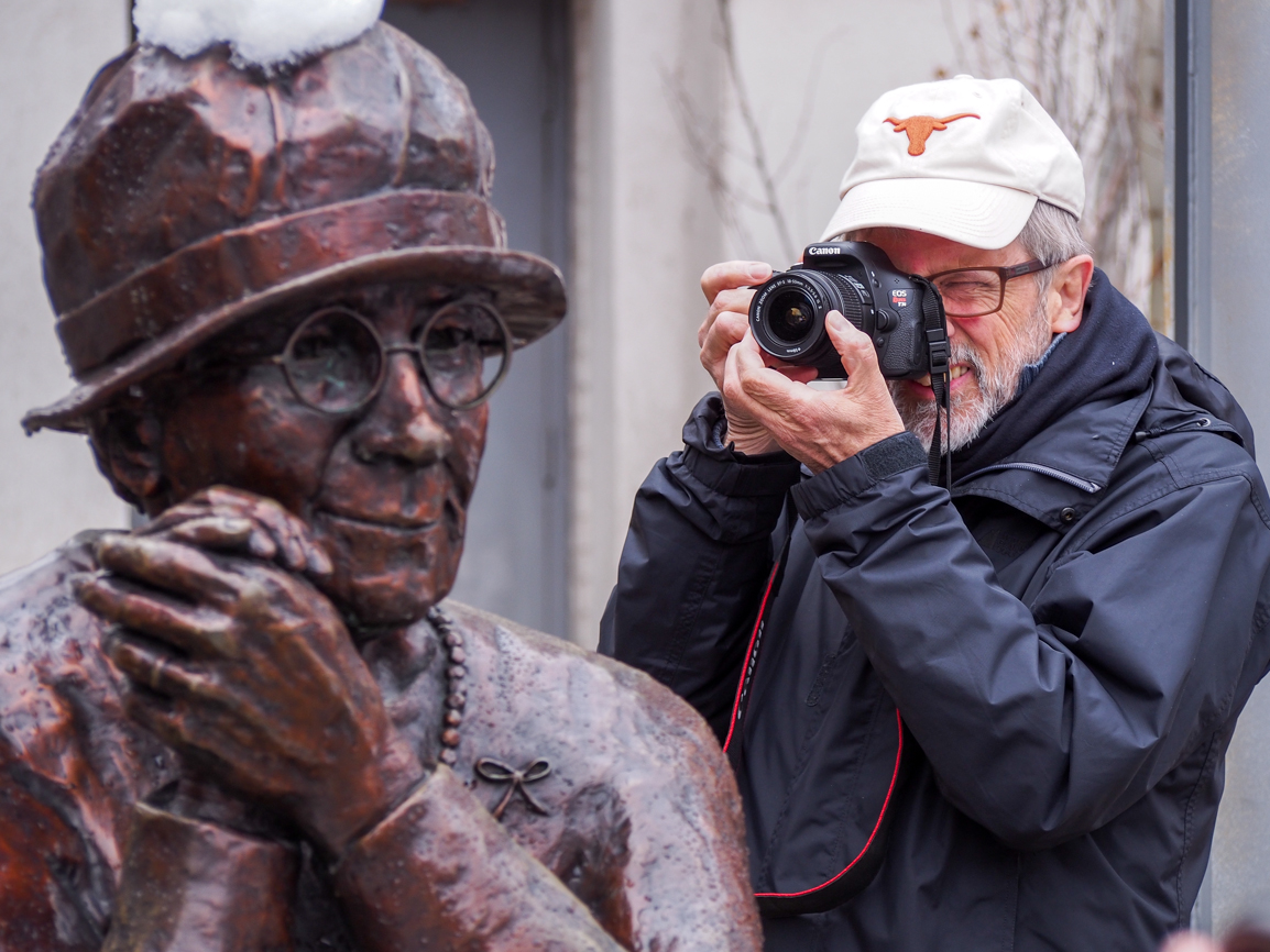 Author Ted Bishop and Barbara Patterson's Women Are Persons! sculpture in Olympic Plaza.   Photo: Leo Aragon