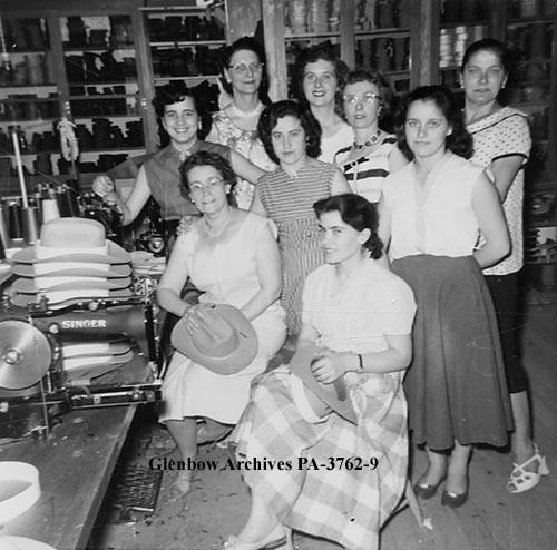 Employees at Smithbilt Hats in circa 1958 at its factory on 1208-1st Street SW. The site is now marked by  a historical plaque  at Hotel Arts. In 1946, Smithbilt produced its first white cowboy hat for city oilman Bill Herron. Two years later, it supplied Calgary's delegation with white hats to wear during Grey Cup festivities in Toronto, and a tradition was born. (Photo: Glenbow Archives)