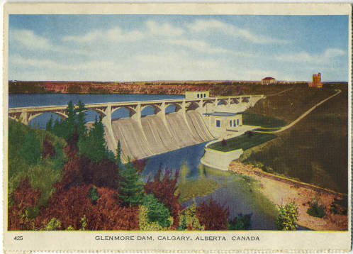 "Completed in 1933 and costing $4 million, the Glenmore Dam was the largest public works project in the city's history, providing needed employment during the first years of the Dirty Thirties. The dammed Elbow River flooded 900 acres of land to create the Glenmore Reservoir. In the 1940s, the area was considered a ""swimming, fishing and picnicking paradise."" Later, the reservoir was closed to swimmers and power boaters, but not to the literary imagination. (Photo:  Calgary Public Library Postcards from the Past )"