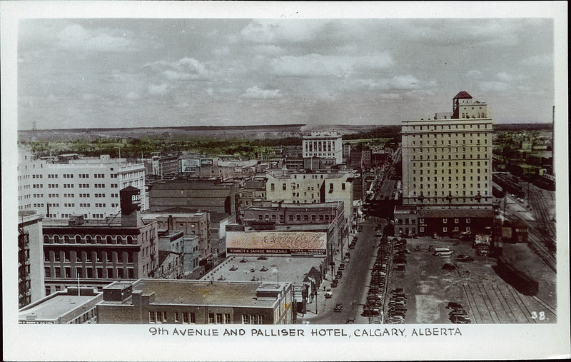 Calgary's iconic Palliser Hotel makes a cameo appearance in Katherine Govier's latest novel. This view from the 1940s looks east down Ninth Avenue with the hotel on the right. (Photo: University of Alberta Peel Collection,  Prairie Postcards )