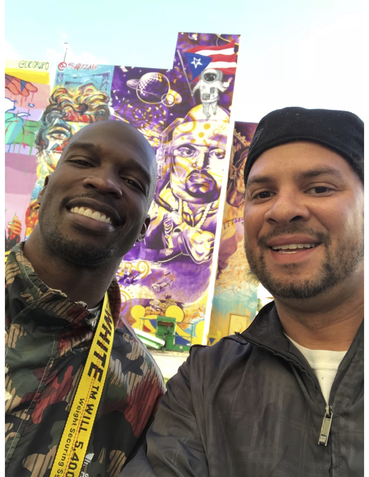 """Chad """"Ochocinco"""" Johnson and Kyle Holbrook at the Puerto Rico Hope mural, Ochocinco was artistically shooting photography of the mural when KYLE SAW HIM, THATS WHAT """"ARTWORLD"""" IS ALL ABOUT!!!"""